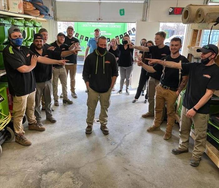 Crew Pointing at SERVPRO Production Manager